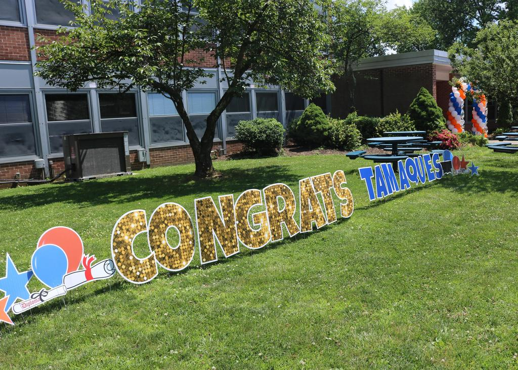 Photo of Congrats Tamaques sign on lawn.