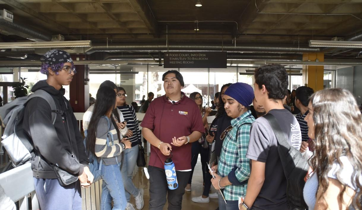 Cal State Dominguez Hills Rep speaking with students