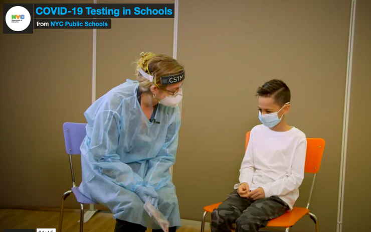 Health care worker testing student for covid