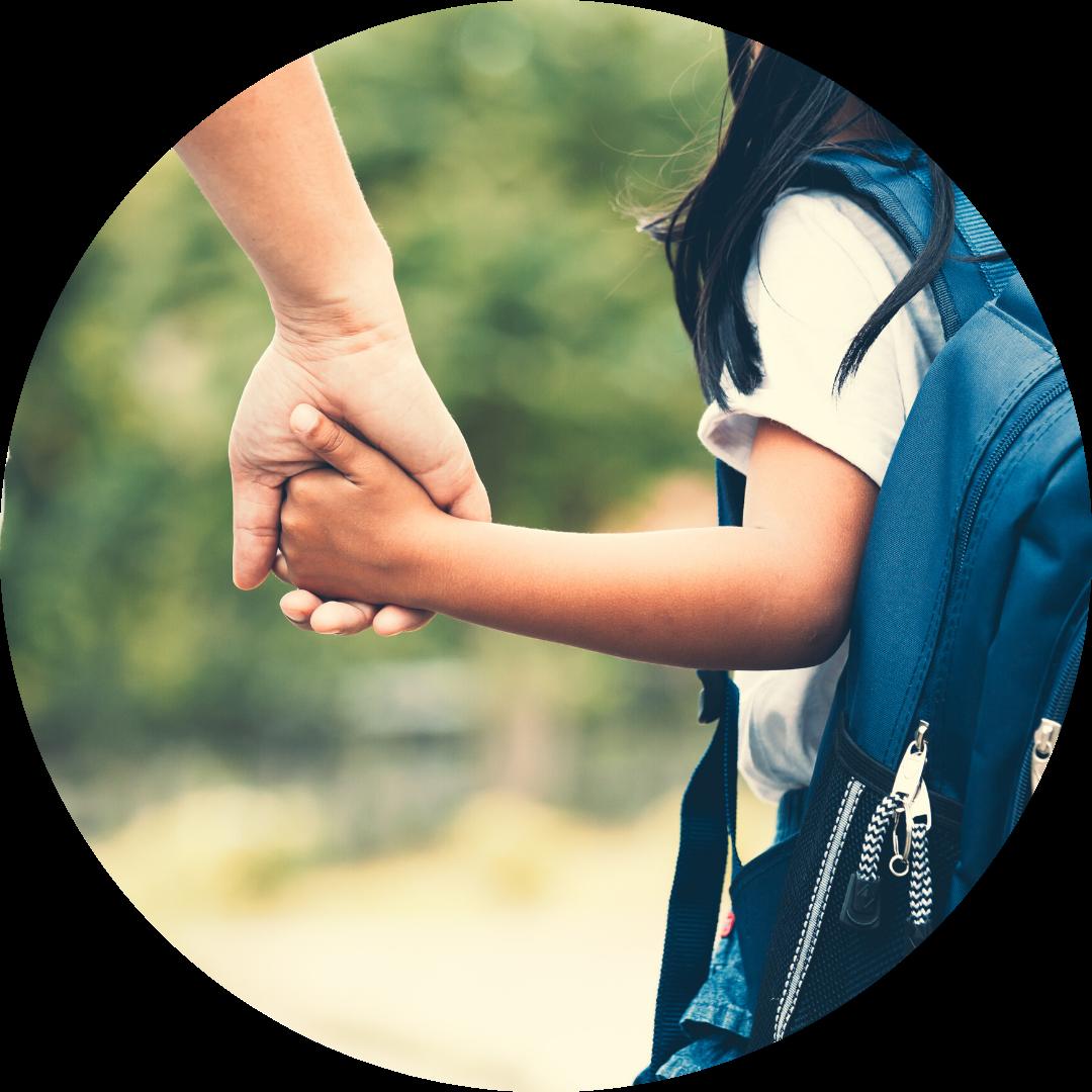 child & parent holding hands