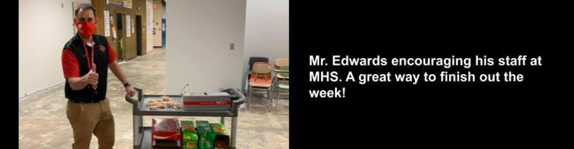 Mr. Edwards encouraging his staff at MHS with drinks and cookies.