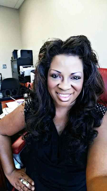 Dr. Teresa Holmes smiling in her office.