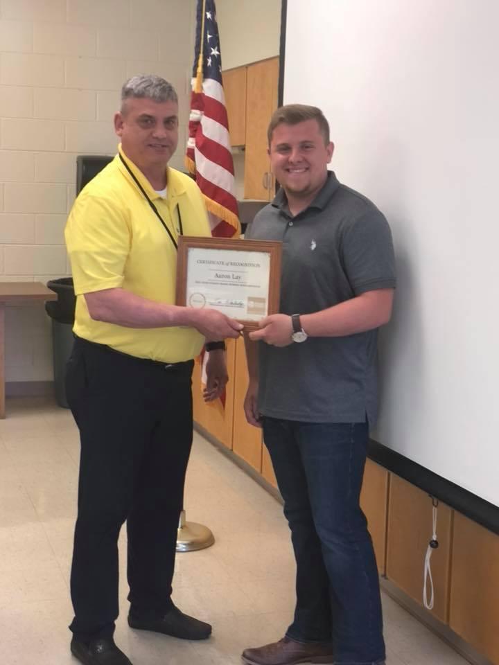 Tim Blankenship presenting award to Aaron Lay