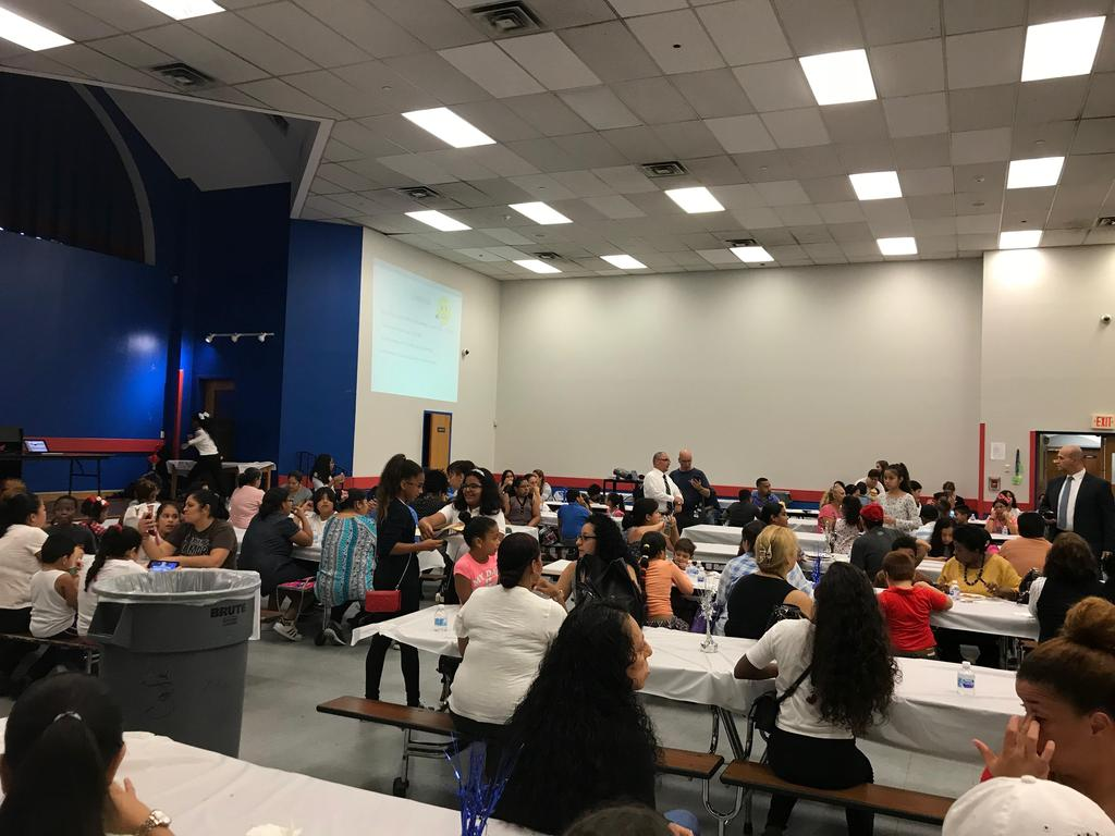 parent enjoying a meal before back to school night