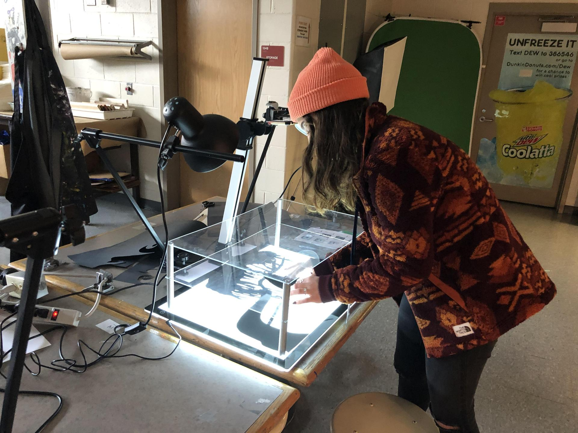 Student working at light box