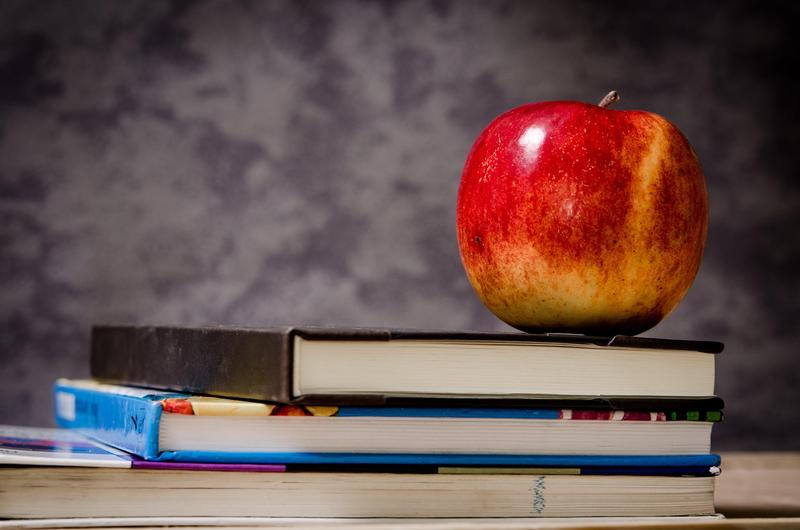 Public School Week. An apple on top of books.