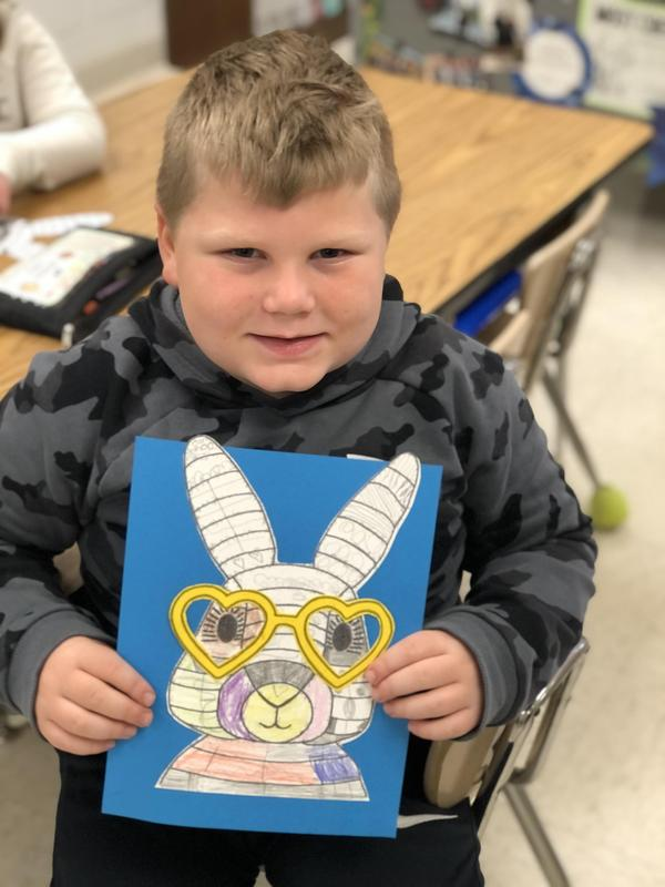 boy with easter drawing