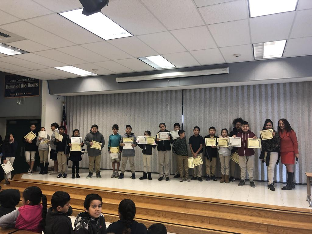 trimester one award winners in Ms. Murillo's class pose for picture