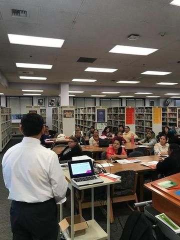 Mr. Espinoza speaking with parents.