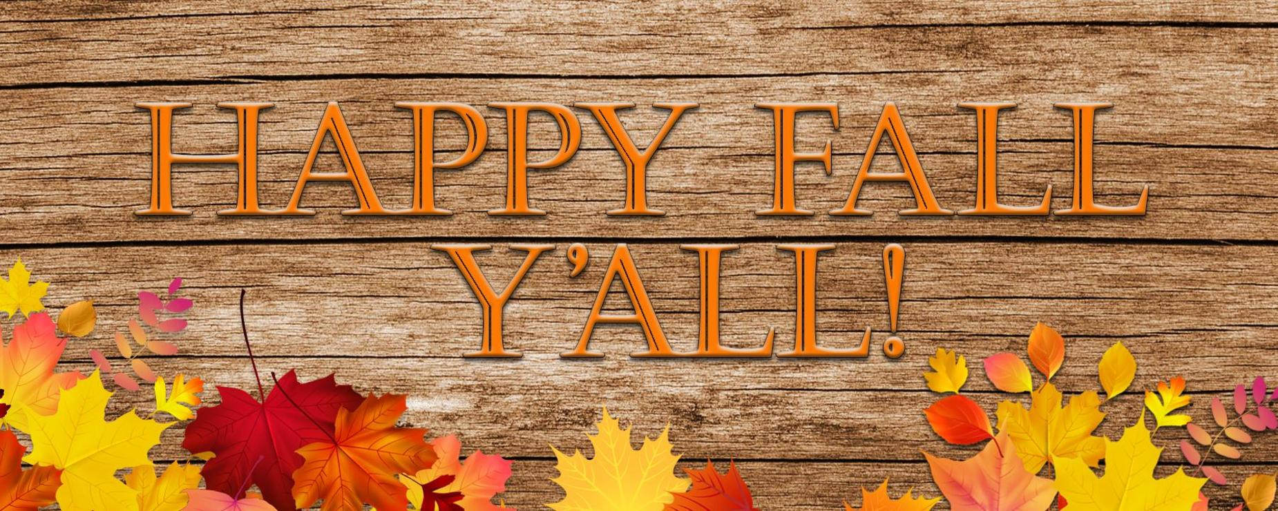 Happy Fall! written on wood background with leaves..