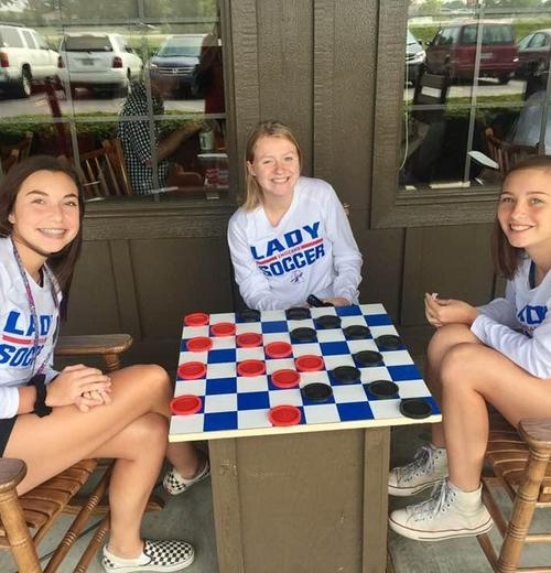 soccer girls playing checkers