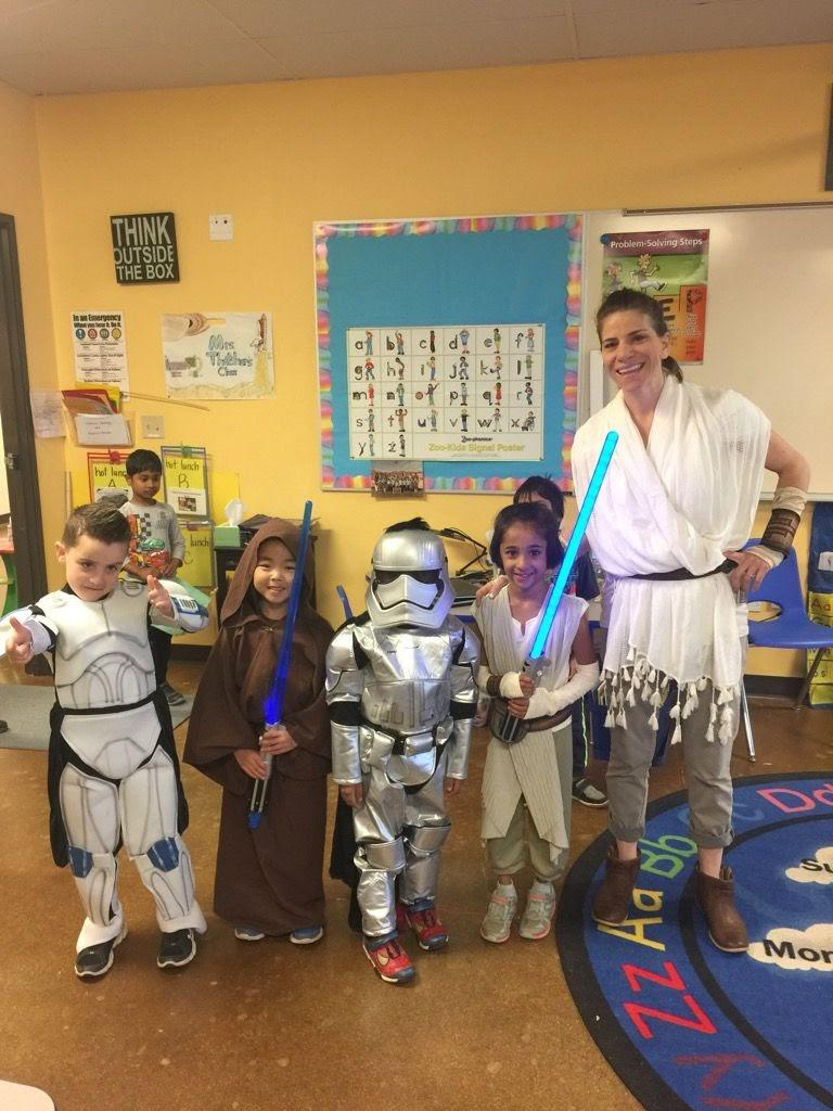 A group of students and their teacher dressed as Star Wars characters