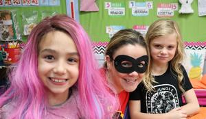 Photo of McKinley students and teacher dressed up for Halloween.