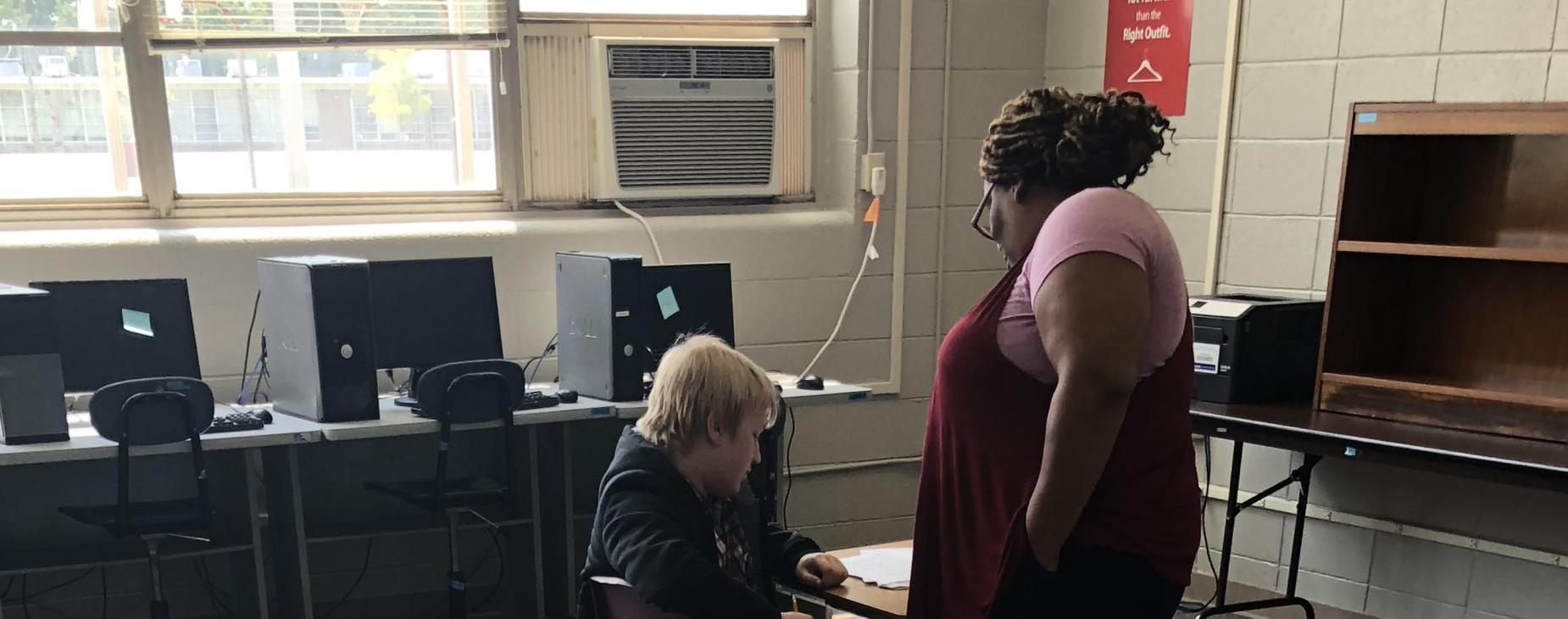 Ms. Dooley engaged with student.