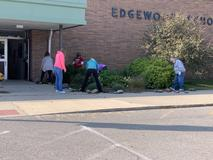 Staff cleans up around the school