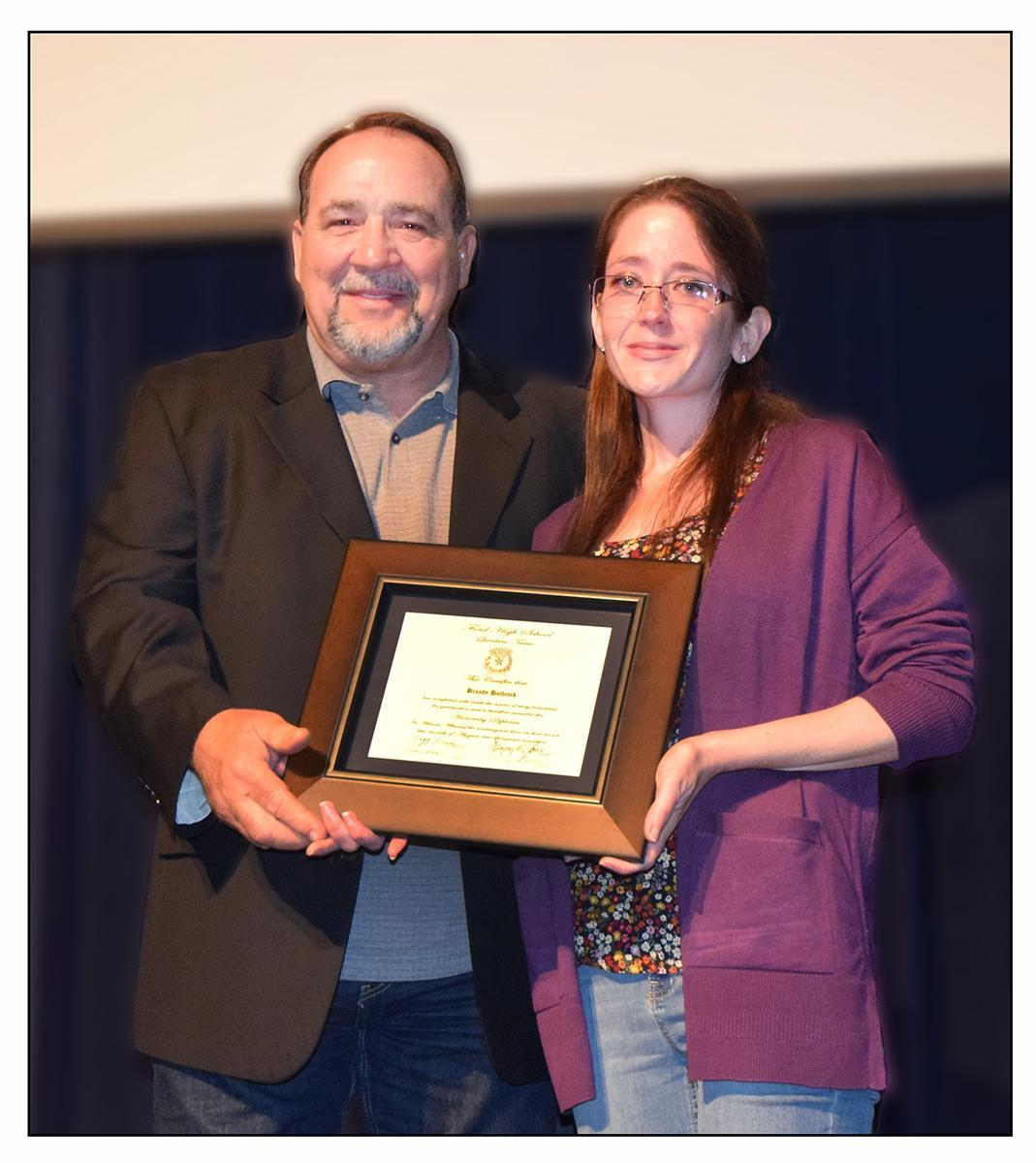 Brandy Hathcock receives diploma from Board President, Kenny Stone