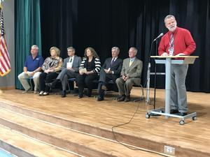 Riverbank Elementary Principal David Sims, right, opens Tuesday's program.