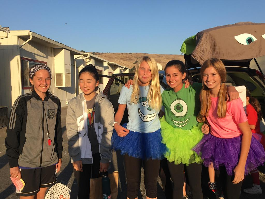 girls dressed in costumes from Monsters Inc