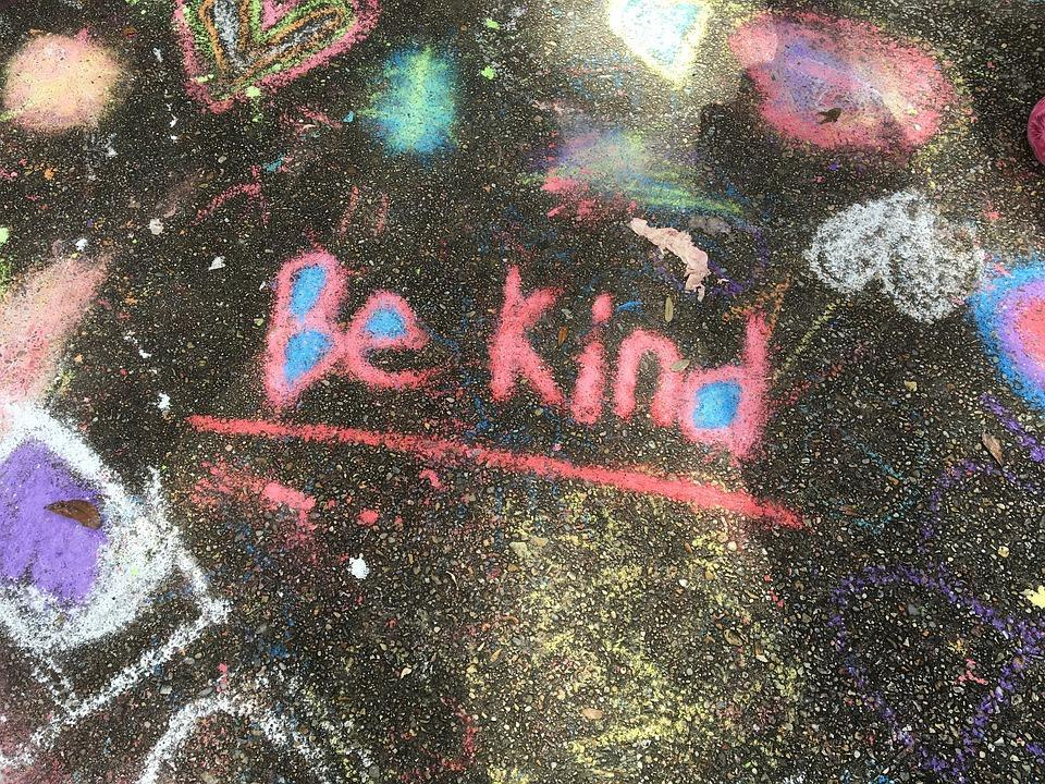 chalk on street spelling the words be kind