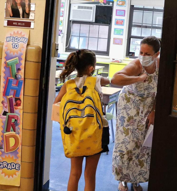 Photo of teacher & student elbow bumping on first day of school.