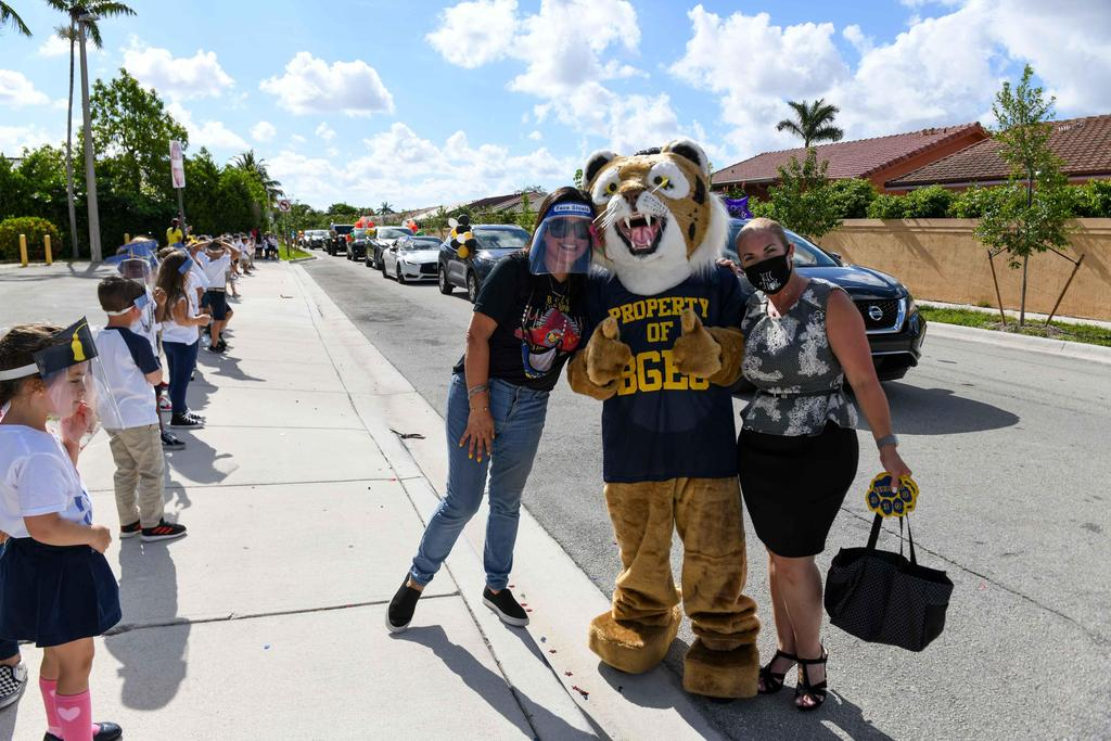 Ms. Riveron and Ms. Martinez with Bobby the Bobcat
