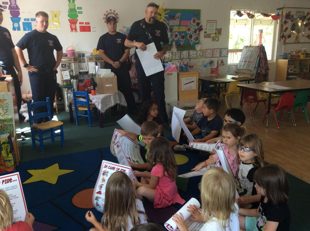 children and firemen