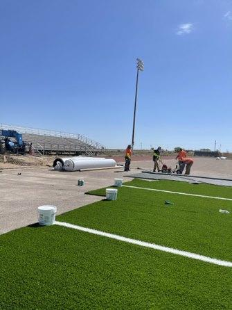 Rolling out the new turf at Crownpoint High Stadium