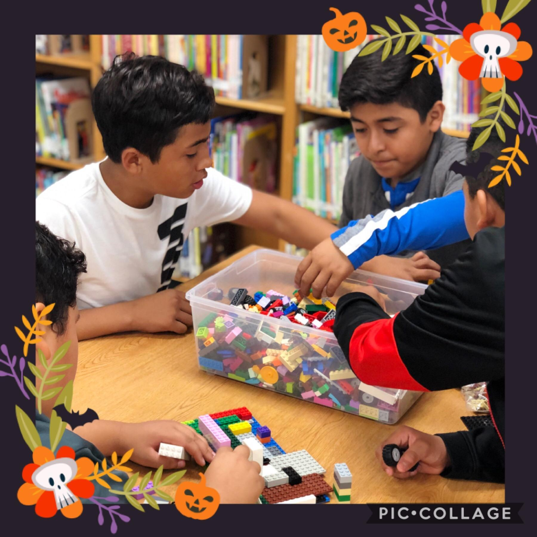 Group of students build with Legos
