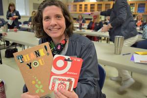 school nurse holding cards smiling