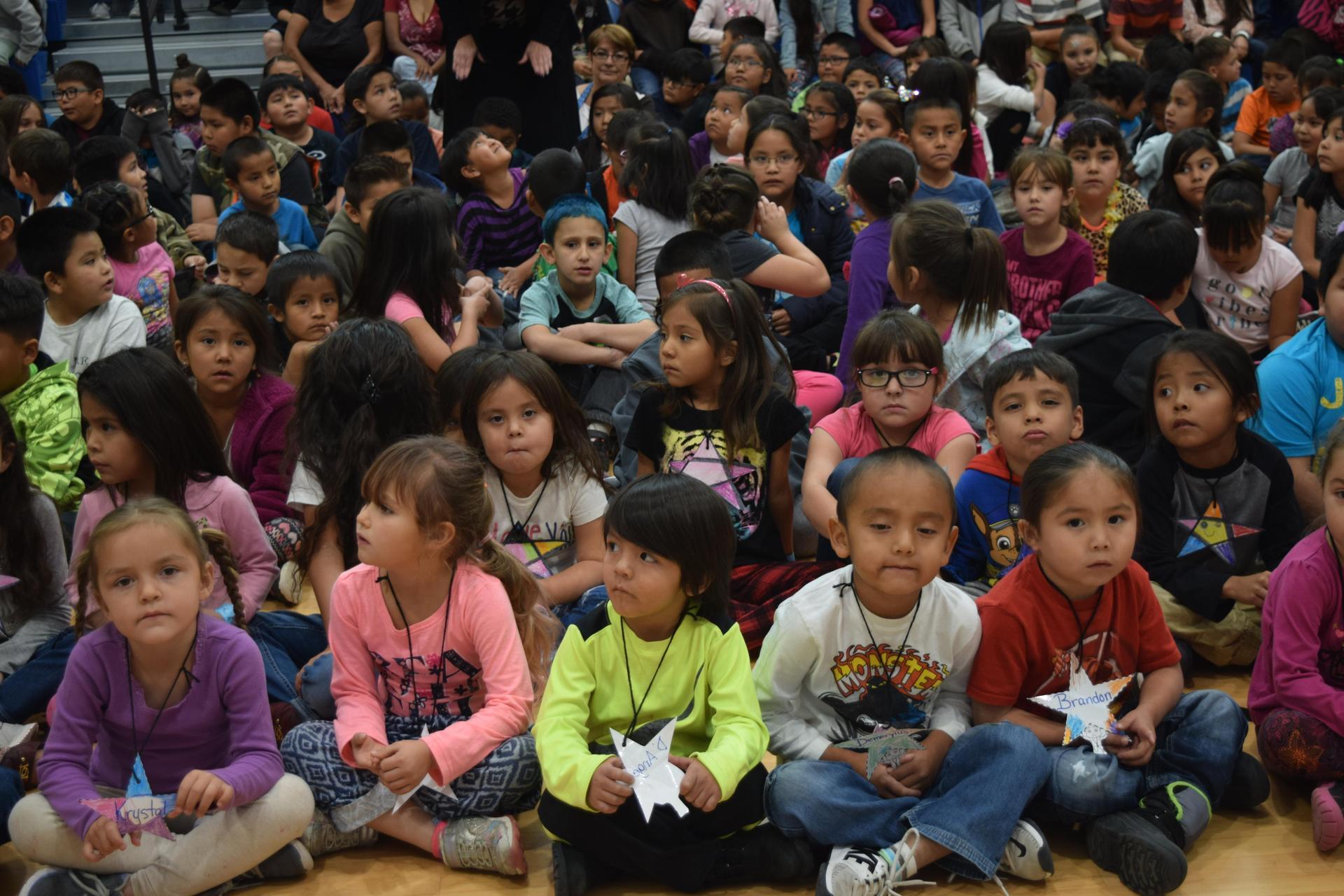 Elementary kids sitting