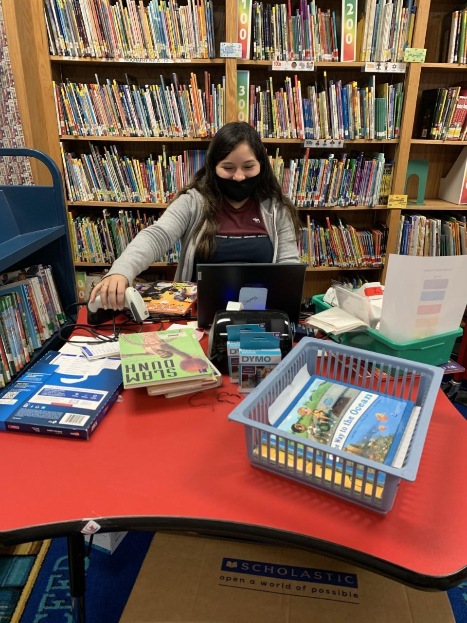 Career Prep Student Betxy Caracheo (12th Grader) - Dudley Elementary Library