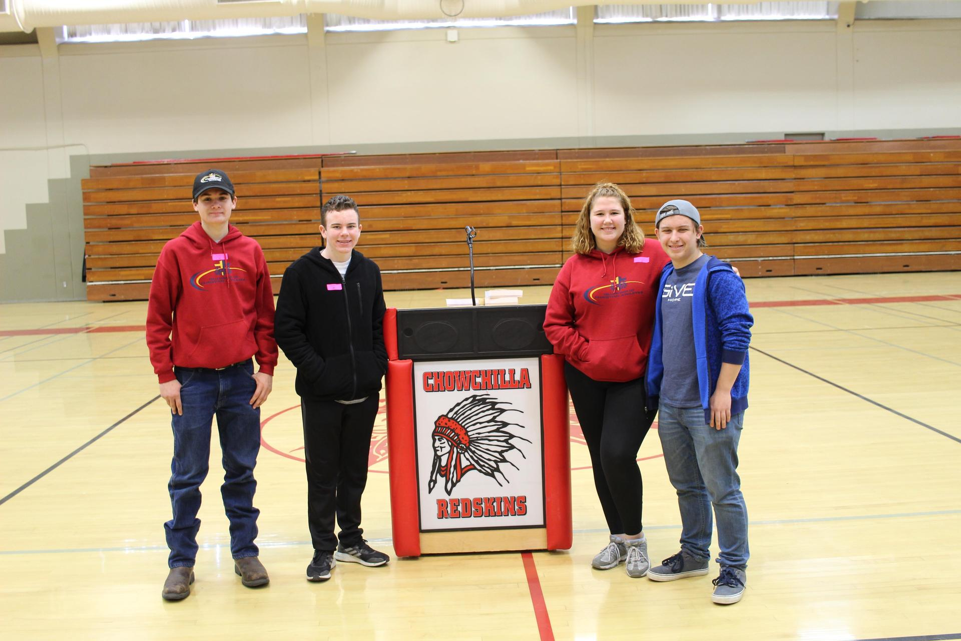 FCA Officers Tyler Henson, Micah Trujillo, Annie Jackson and Andrew Simon posing after the rally