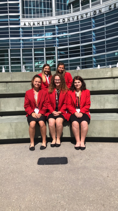 Kylee Miller, Gracie Studer, Alexus Hill, Jasmine Ondesko and Anastasia Jones pose in front of the conference center in Anaheim.