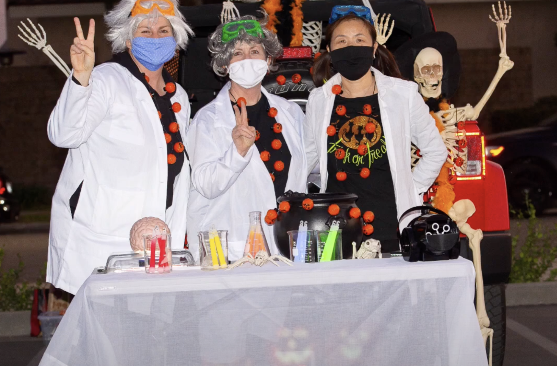 Teachers in crazy lab costumes