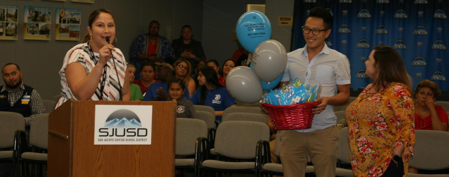 Community Engagement Specialist Cara Adame recognizes San Jacinto Smiles Dentistry for their donations and support of SJUSD students and families.