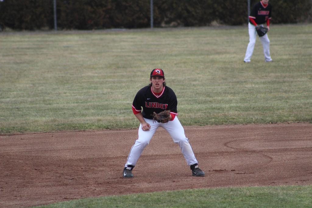 Baseball player fielding a ball