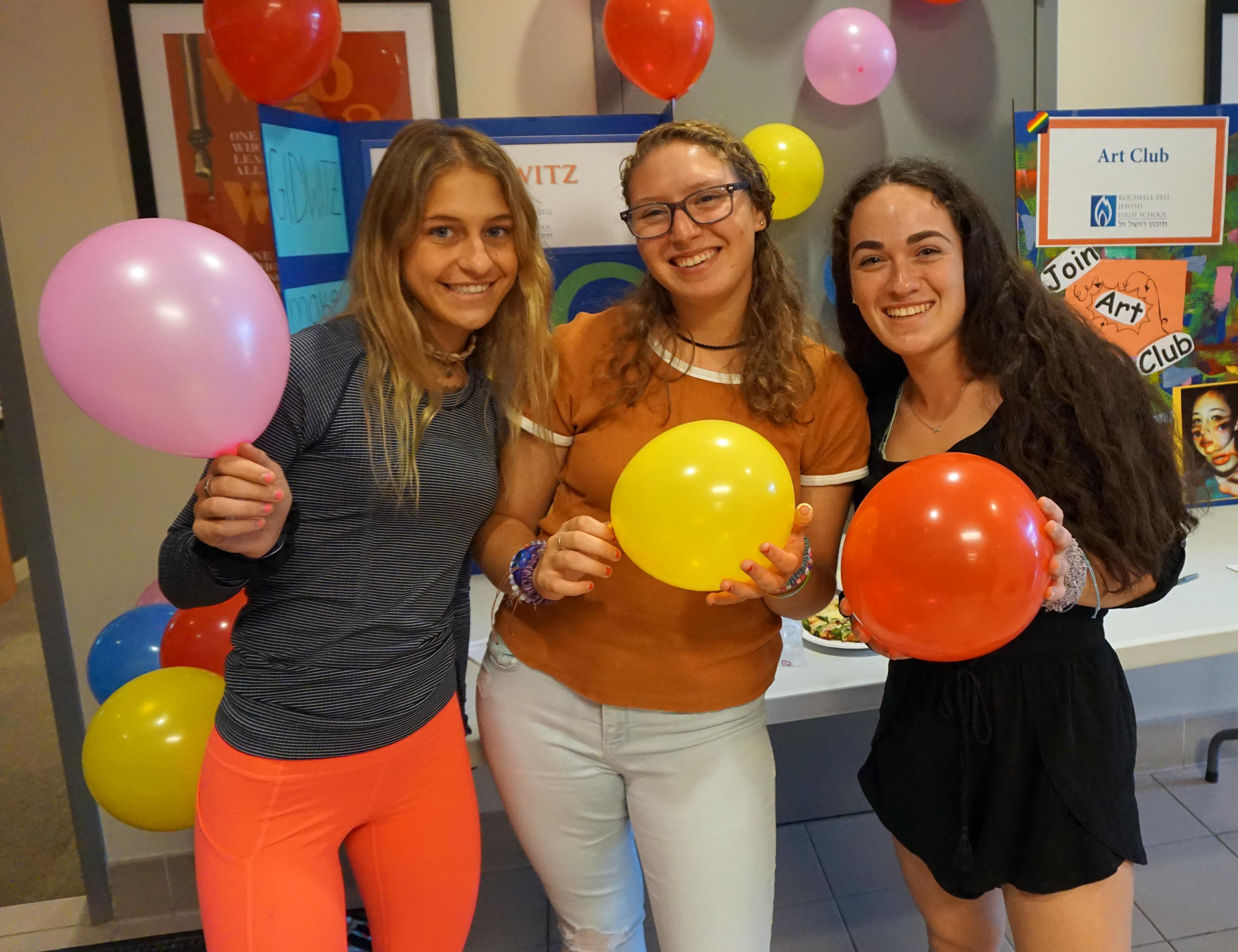 Students holding balloons