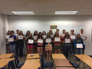 students holding a certificate