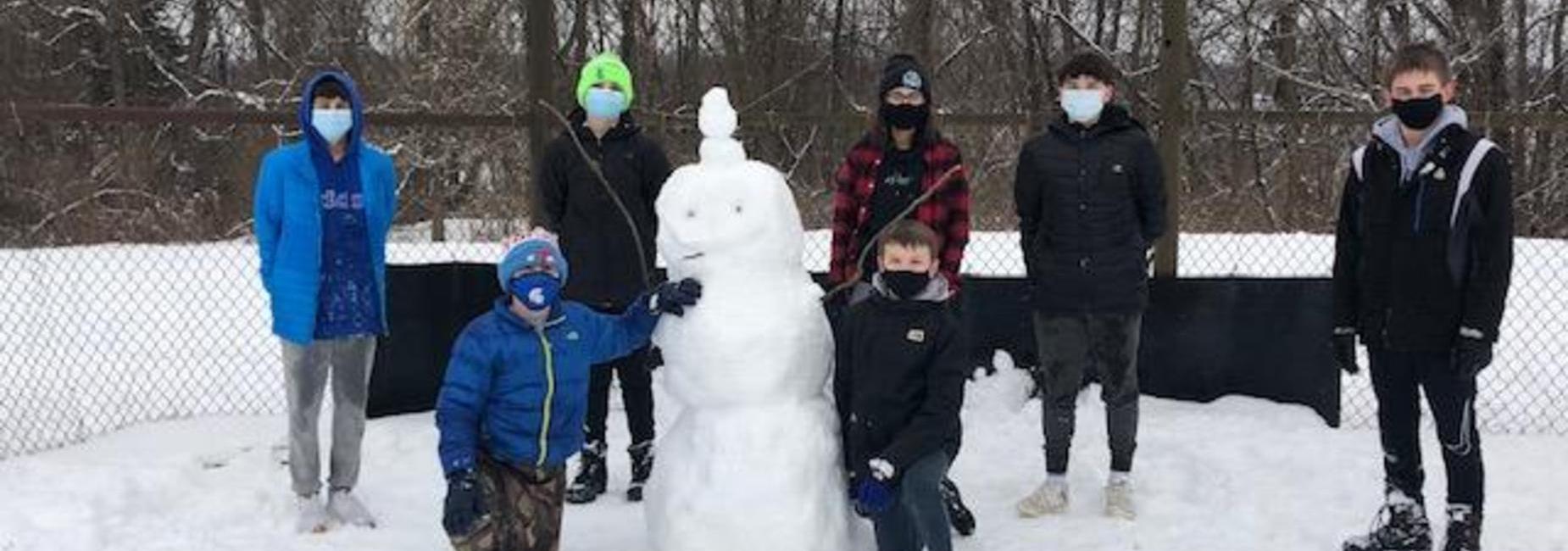 kids building snow man