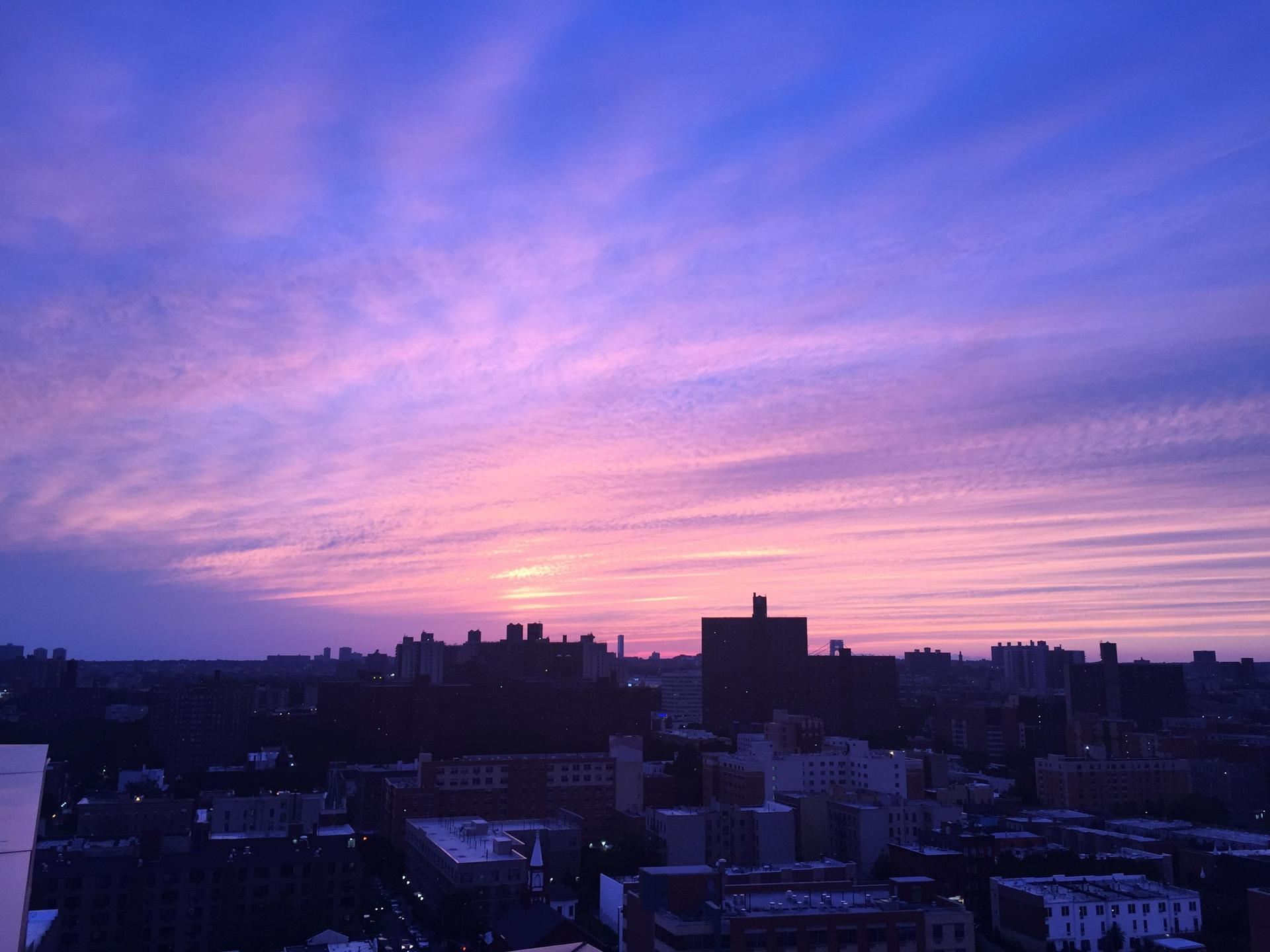 nyc sunset with bright pinks and purple skies