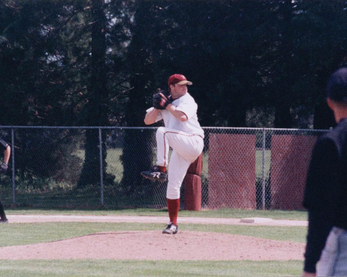 Christ George '97 pitching as a student
