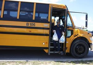 Juan Heredia, a bus driver with Edinburg CISD, delivers food to children in a neighborhood in northwestern Hidalgo County.