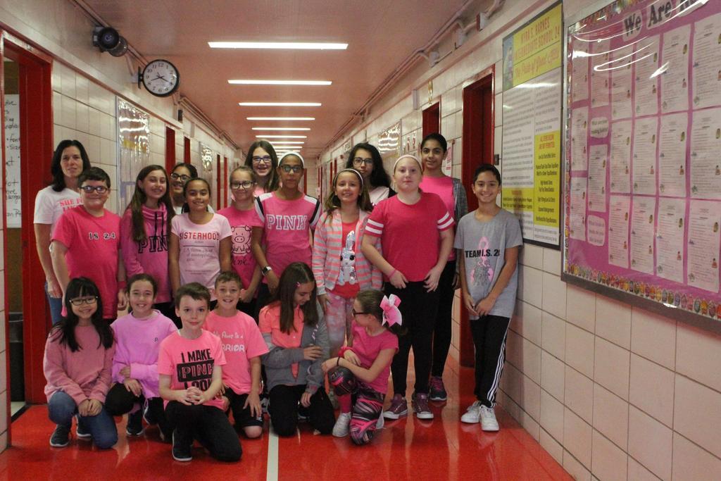Mrs. Whelan and sixth grade students wear pink
