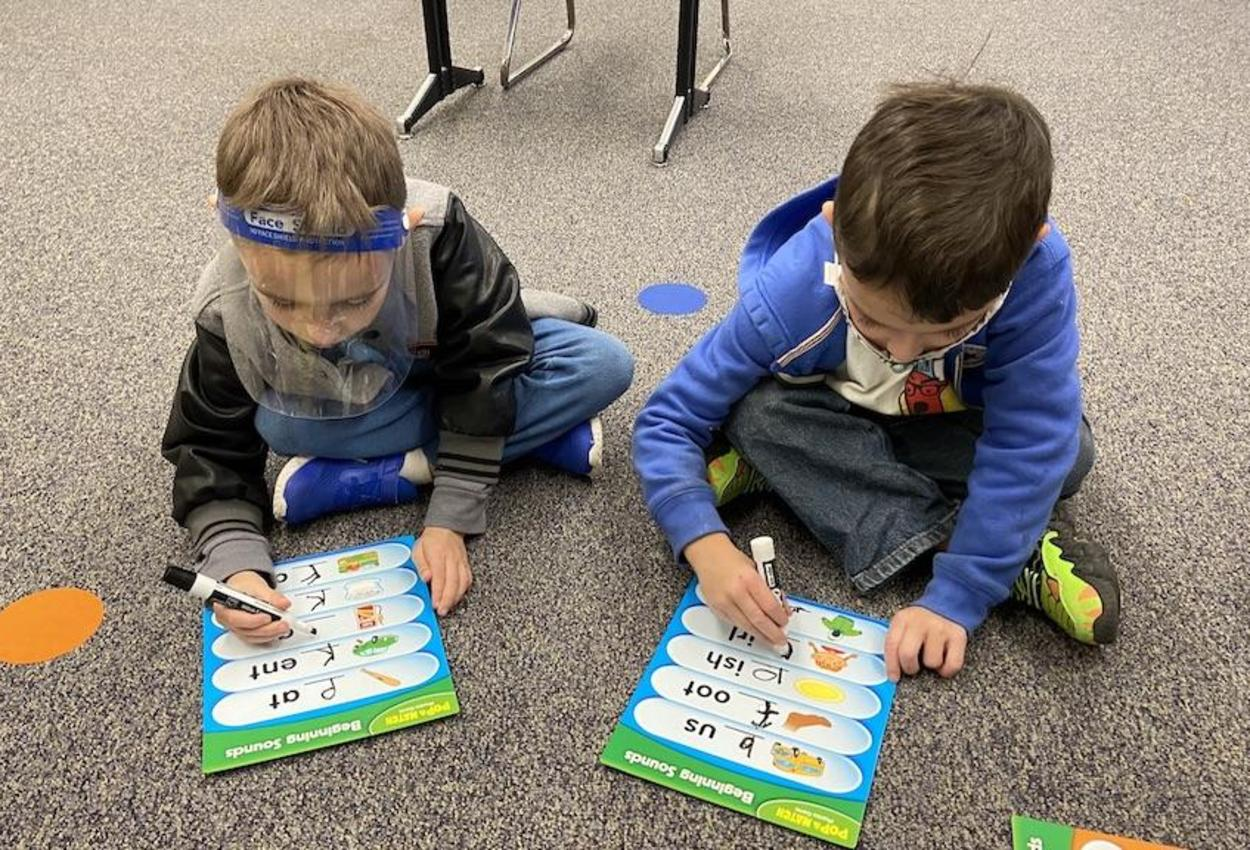 students working on spelling lesson