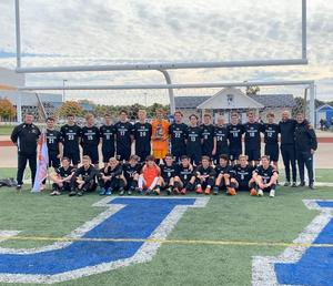 TKHS soccer team wins district title.