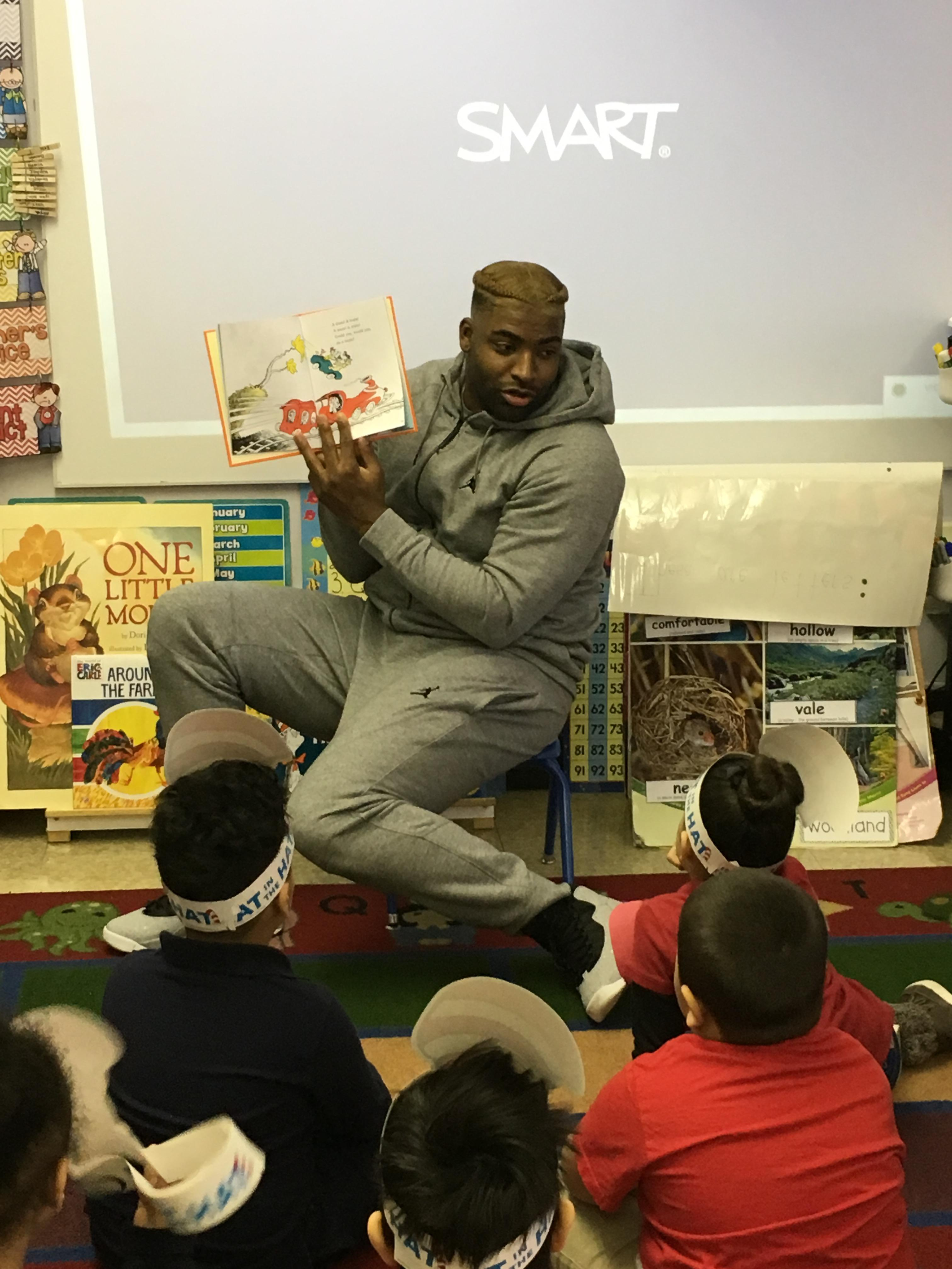 DE-Vinny Curry, NFL player reading to students at Edison School