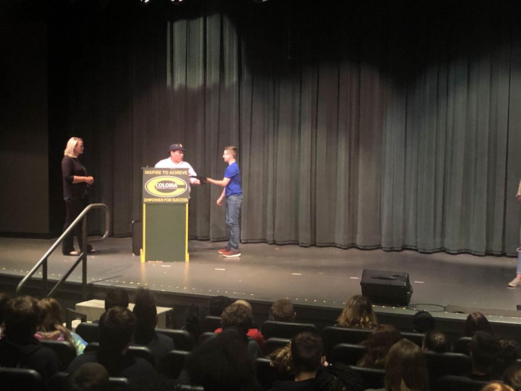 Skylar accepting American Legion Award