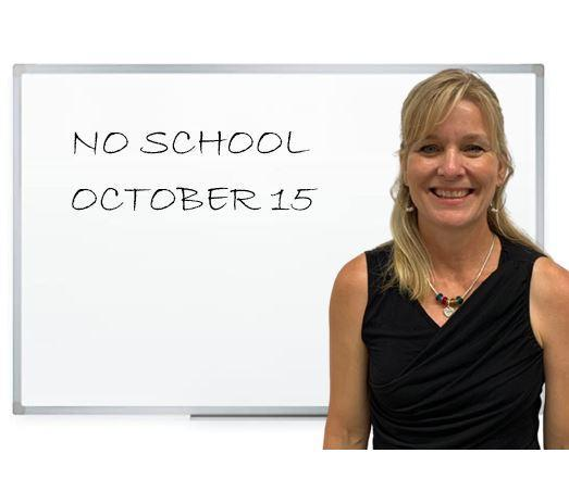 teacher with sign that says no school