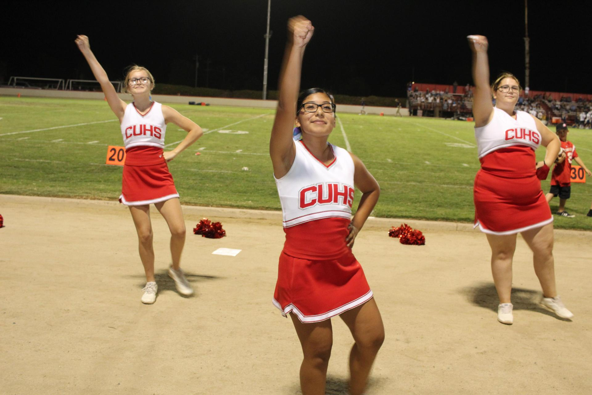 Cheerleaders cheering at the varsity game against central valley christian