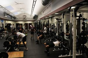 Student Athletes lifting weights